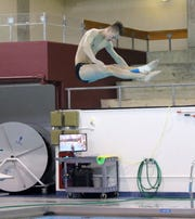 State qualifier Randy Beach of Elmira practices diving during practice at Ernie Davis Academy on Feb. 22, 2019.
