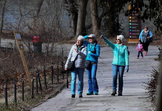 Enjoying a February walk through Evansville's Mesker Park Zoo, left to right, Barb Keusch, Jasper, Stacy Phillips visiting from Alaska, and Carol Brock, Jasper, spy something interesting along the trail Tuesday, February 26, 2019.