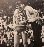 Tell City's Bryan Taylor with coach Bob Lochmueller.
