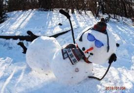 Linda and Dennis Hemauer's Fond du Lac yard is decorated with snowmen each winter.
