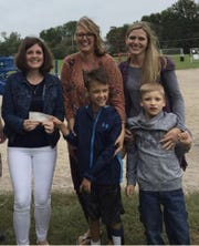 The Access 4 Recess team held fundraisers to build an all-abilities playground at Rock River Intermediate School in Waupun. From left, Brittany Horvath, Kendra Ter Beest and her son Brysen, Naomi Beahm and her son Cameron.