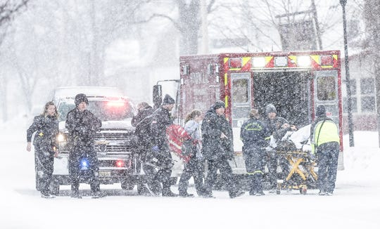 Fond du Lac Police officers secure a scene while Fond du Lac Fire/Rescue personel load a person who was shot in the leg Tuesday, February 26, 2019 on Lincoln Avenue, north of Division Street in Fond du Lac, Wis. Doug Raflik/USA TODAY NETWORK-Wisconsin