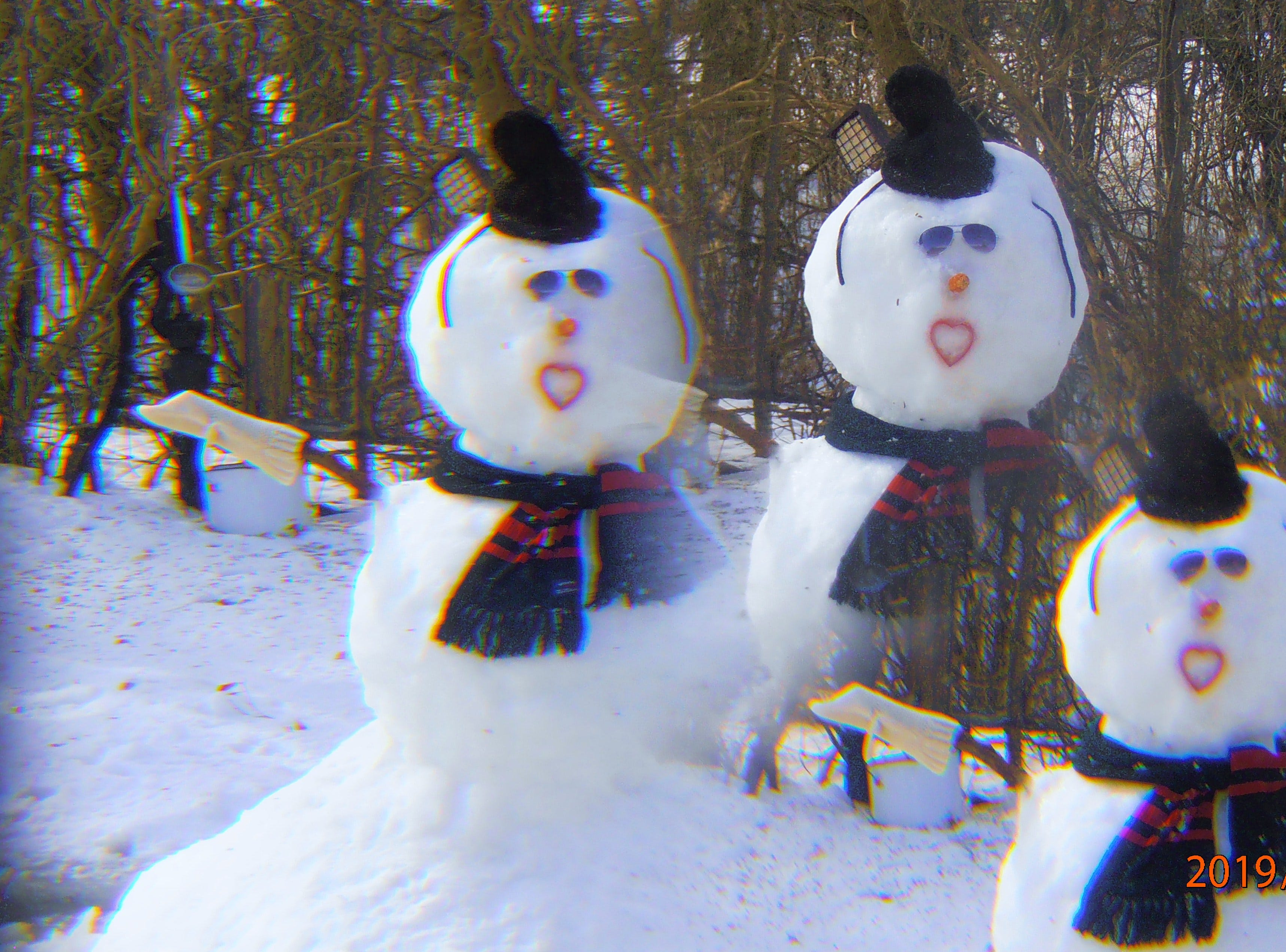 One of the Hemauers' snowmen as seen through a sun catcher. Linda and Dennis are retired and enjoy creating and decorating snowmen.