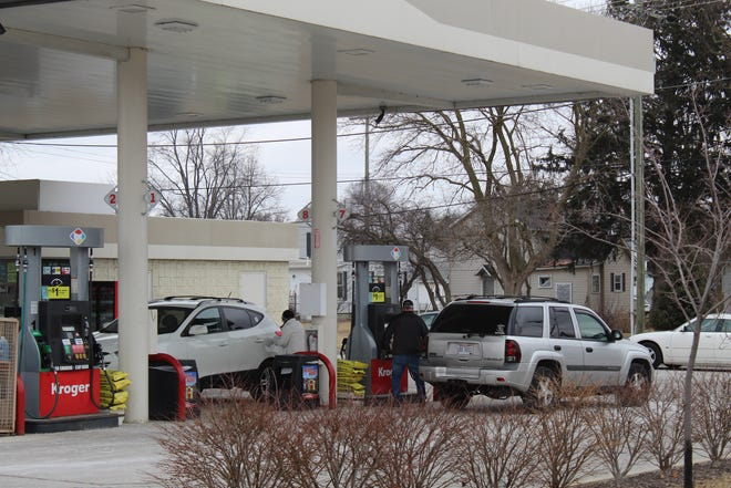 Customers pumped gas at the Kroger gas station on East State Street Tuesday afternoon. Ohio's proposed 18-cent per gallon gas tax hike would put about $428 million more into local government road funds, including about $3.5 million more in Sandusky County.