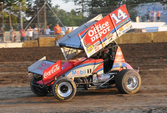 Tony Stewart competes in the 410 sprint car races at the Fremont Speedway on June 27, 2012.