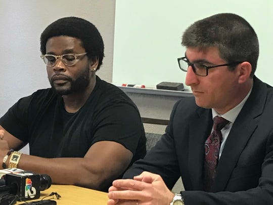 Holley Jones (left) of Lehigh Acres sits with his attorney Solomon Radner at a press conference to announce a federal civil rights lawsuit he filed Tuesday stemming from an encounter he had in April of last year with two Fort Myers police officers who eventually stunned him with a Taser in a Lehigh Acres 7-Eleven.