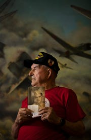 WWII veteran Richard Bergeron, of Cape Coral, displays a photograph of himself from 1942 when he first enlisted in the Army Air Force.