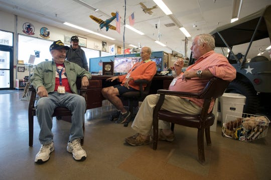 World War II veteran Richard Bergeron, 95, of Cape Coral, interacts with colleagues at the Southwest Florida Military Museum & Library.