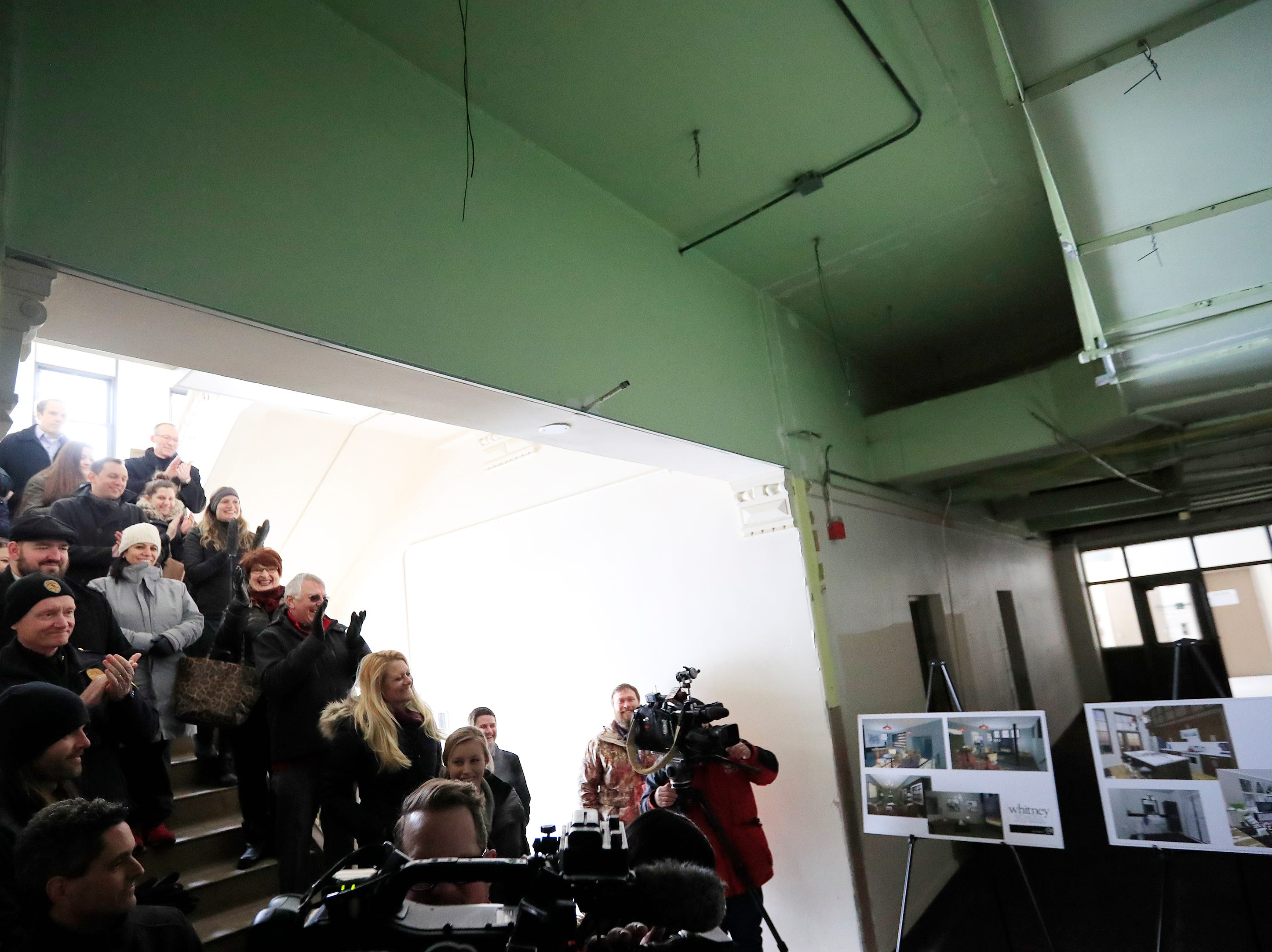 Officials and community members gather at the former Whitney School building to see the plans for converting the building to apartments on Tuesday, February 26, 2019 in Green Bay, Wis.