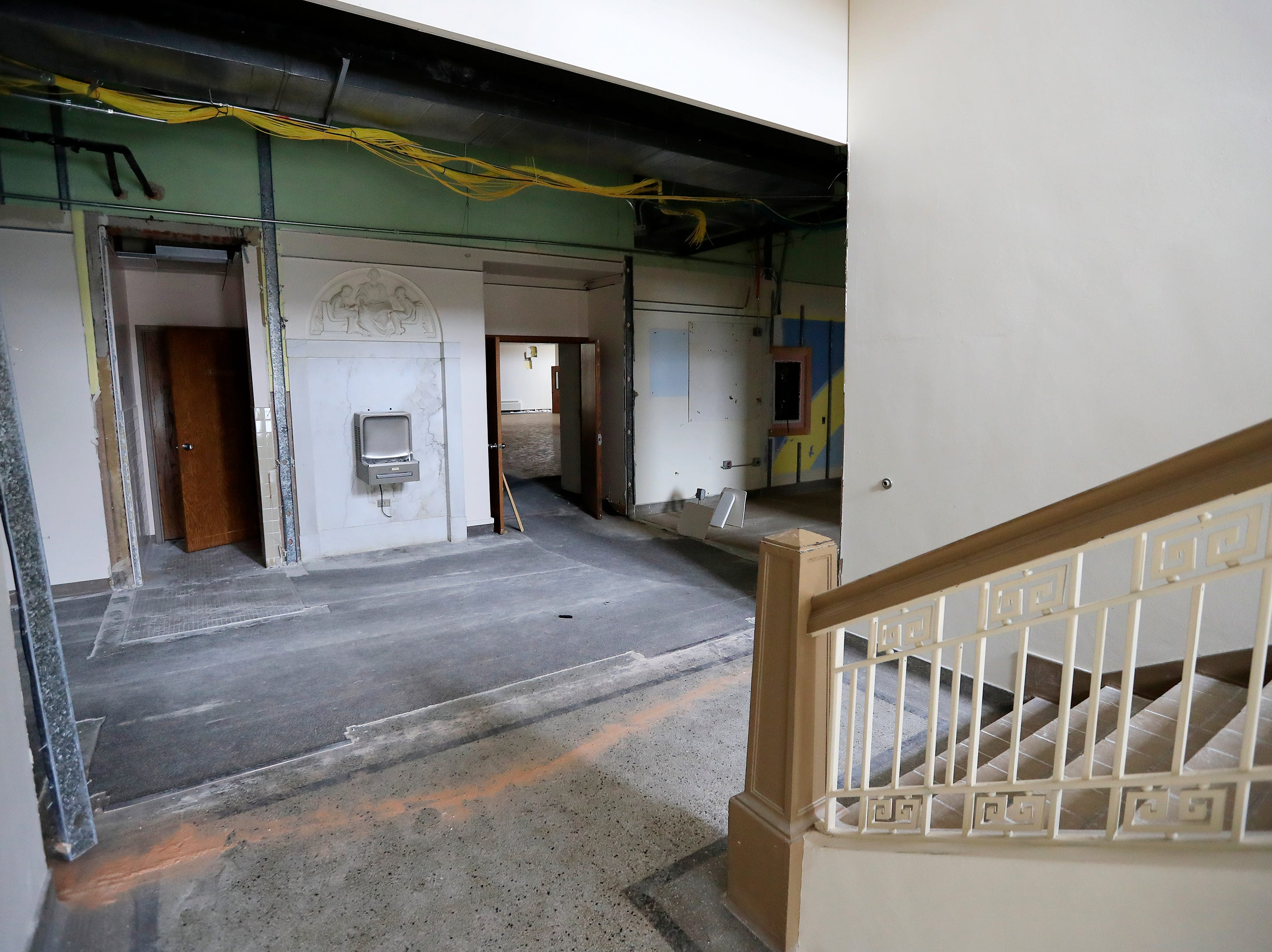 The 2nd floor hallway inside the former Whitney School building is shown on Tuesday, February 26, 2019 in Green Bay, Wis. The building is being converted into apartments this year.