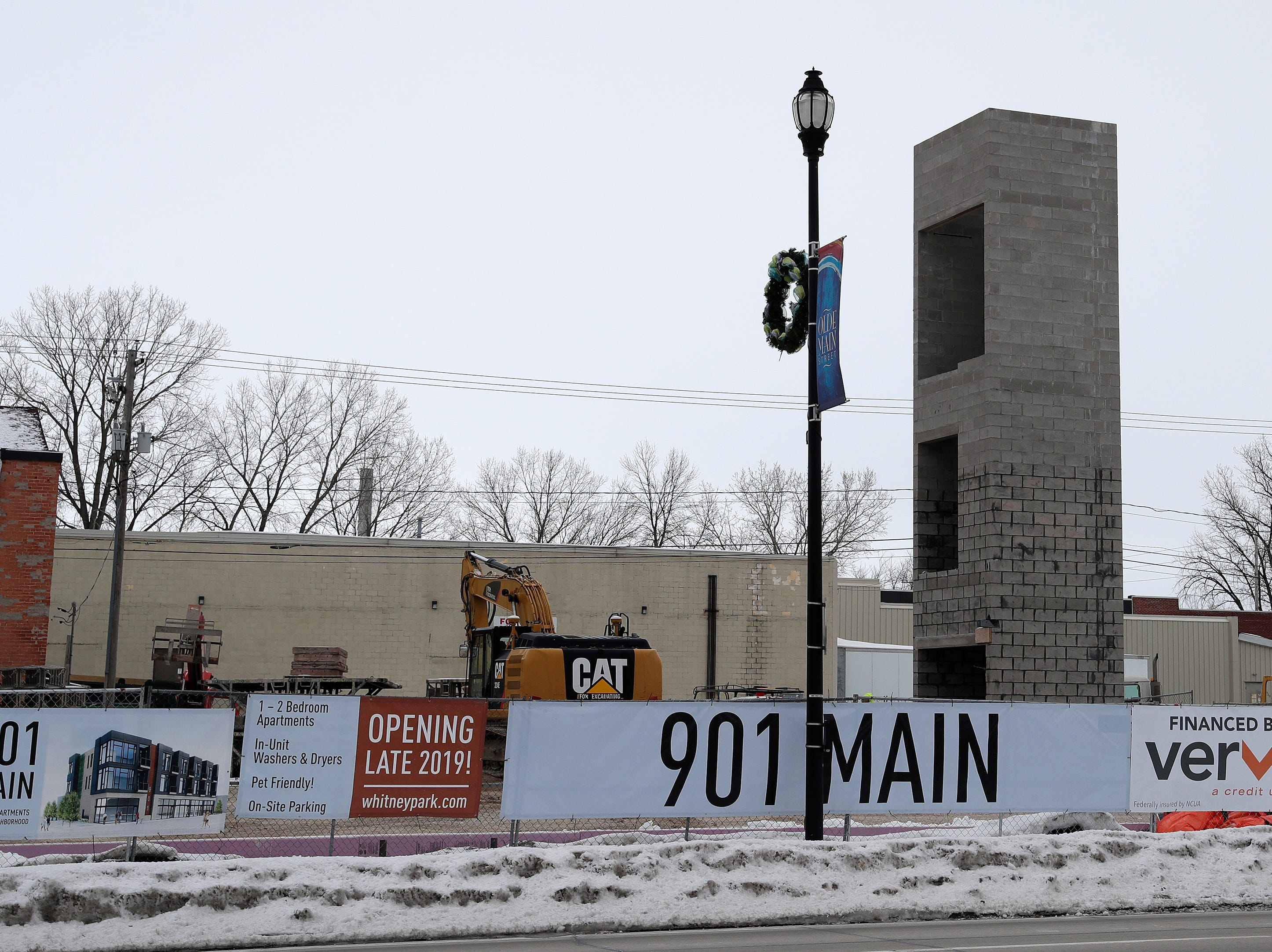 Construction work continues on a mixed-use building on the 900 block of Main St on Tuesday, February 26, 2019 in Green Bay, Wis.