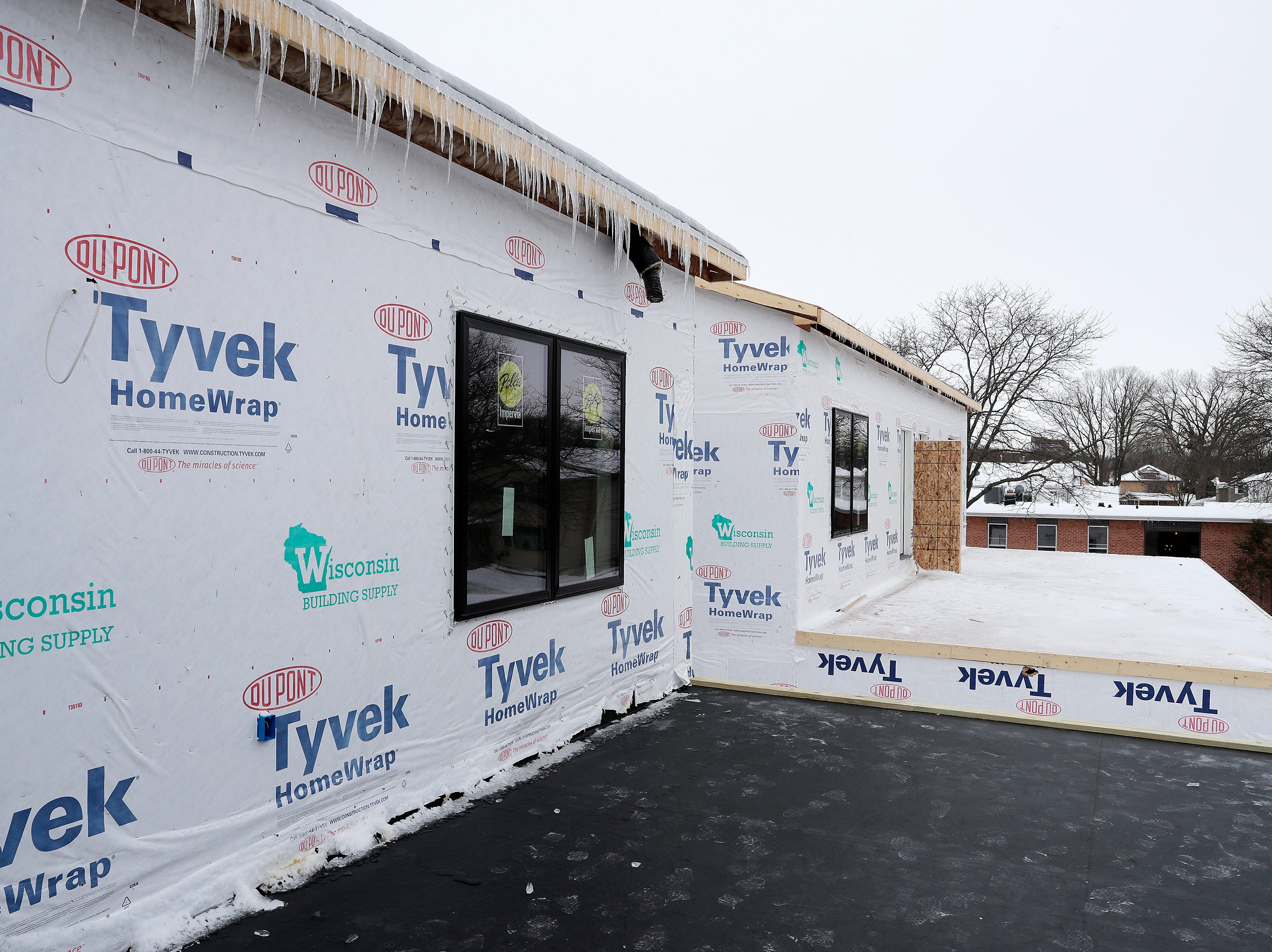 Garage top patios are shown at the under-construction townhouses on the corner of Van Buren and Cherry streets on Tuesday, February 26, 2019 in Green Bay, Wis.