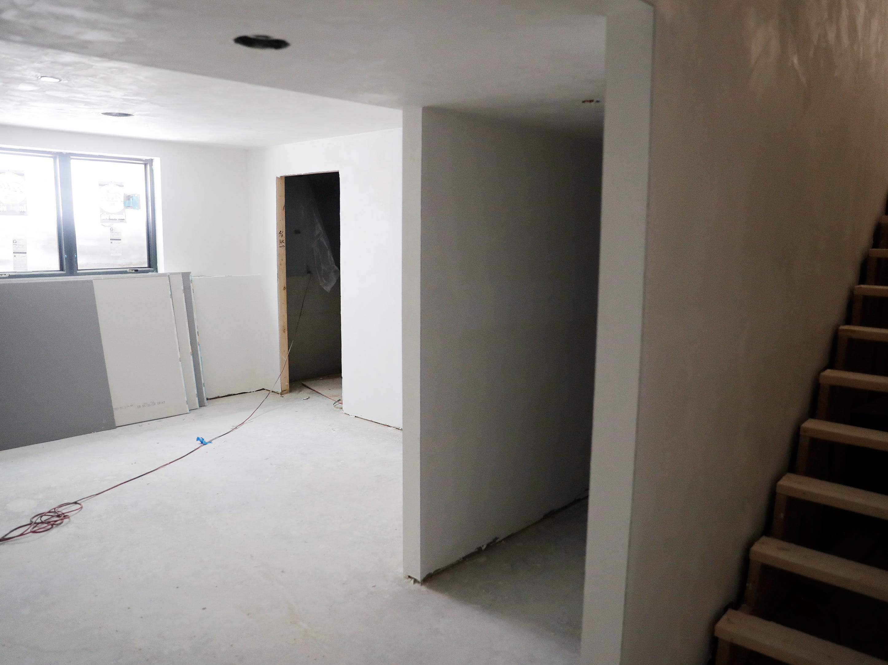 A basement bedroom is shown in the under-construction townhouses on the corner of Van Buren and Cherry streets on Tuesday, February 26, 2019 in Green Bay, Wis.
