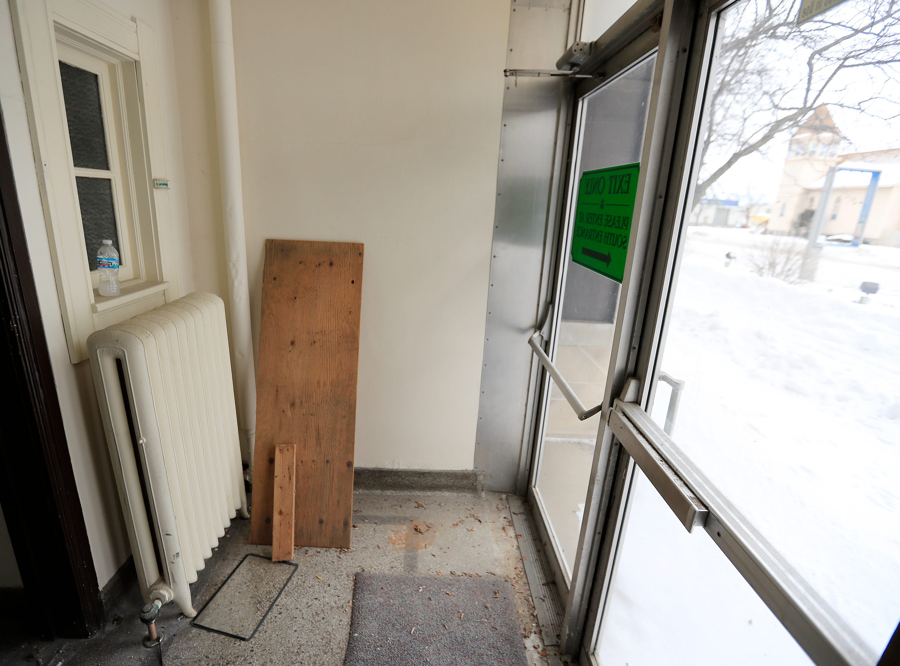 A doorway at the former Whitney School building is shown on Tuesday, February 26, 2019 in Green Bay, Wis. The building is being converted into apartments this year.