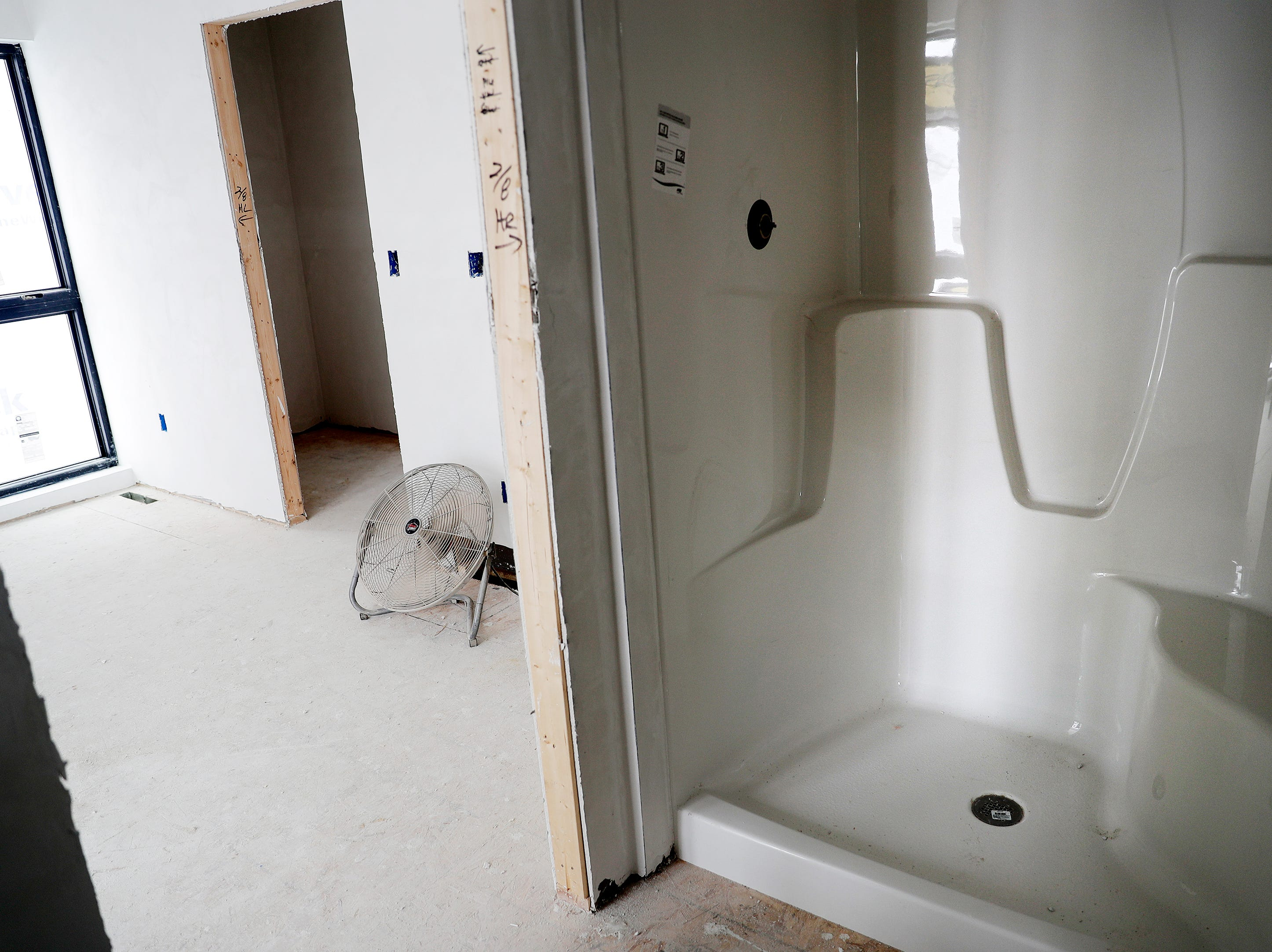 The master bathroom is shown in a unit of the under-construction townhouses on the corner of Van Buren and Cherry streets on Tuesday, February 26, 2019 in Green Bay, Wis.