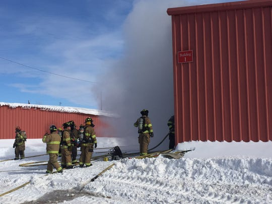 Firefighters combat a blaze at a Great Falls Public Works building on Tuesday afternoon off the Old Havre Highway.
