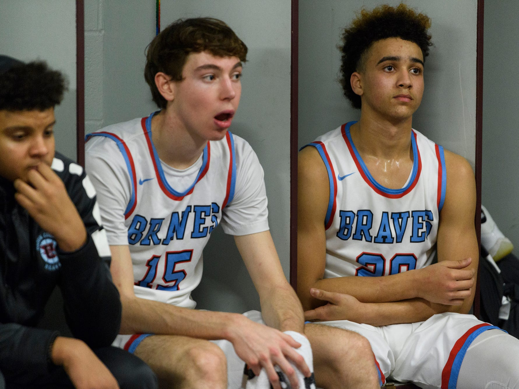 Union County's Elex Dunford (15) and Kale Gaither (20) listen to their coaches during halftime of the Boys Second Region tournament against the Caldwell County Tigers at Madisonville-North Hopkins High School in Madisonville, Ky., Monday, Feb. 25, 2019. The Tigers defeated the Braves 67-64.