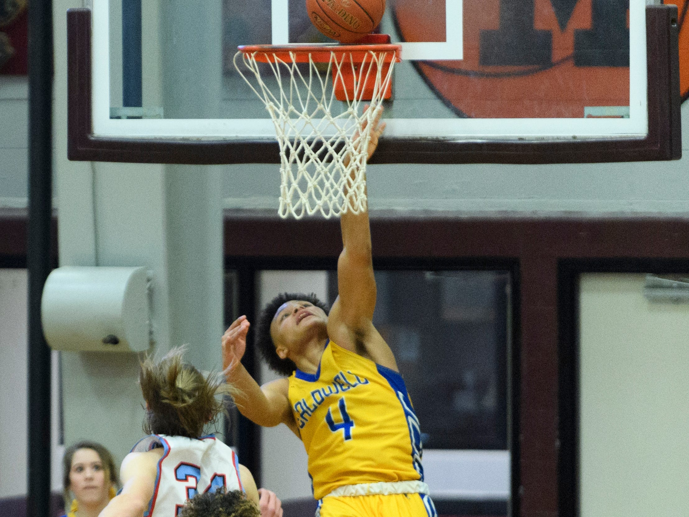 Caldwell County's Derrin Boyd (4) advances to the net during the Boys Second Region tournament against the Union County Braves at Madisonville-North Hopkins High School in Madisonville, Ky., Monday, Feb. 25, 2019. The Tigers defeated the Braves 67-64 to advance to Friday's second region semifinal against University Heights Academy.