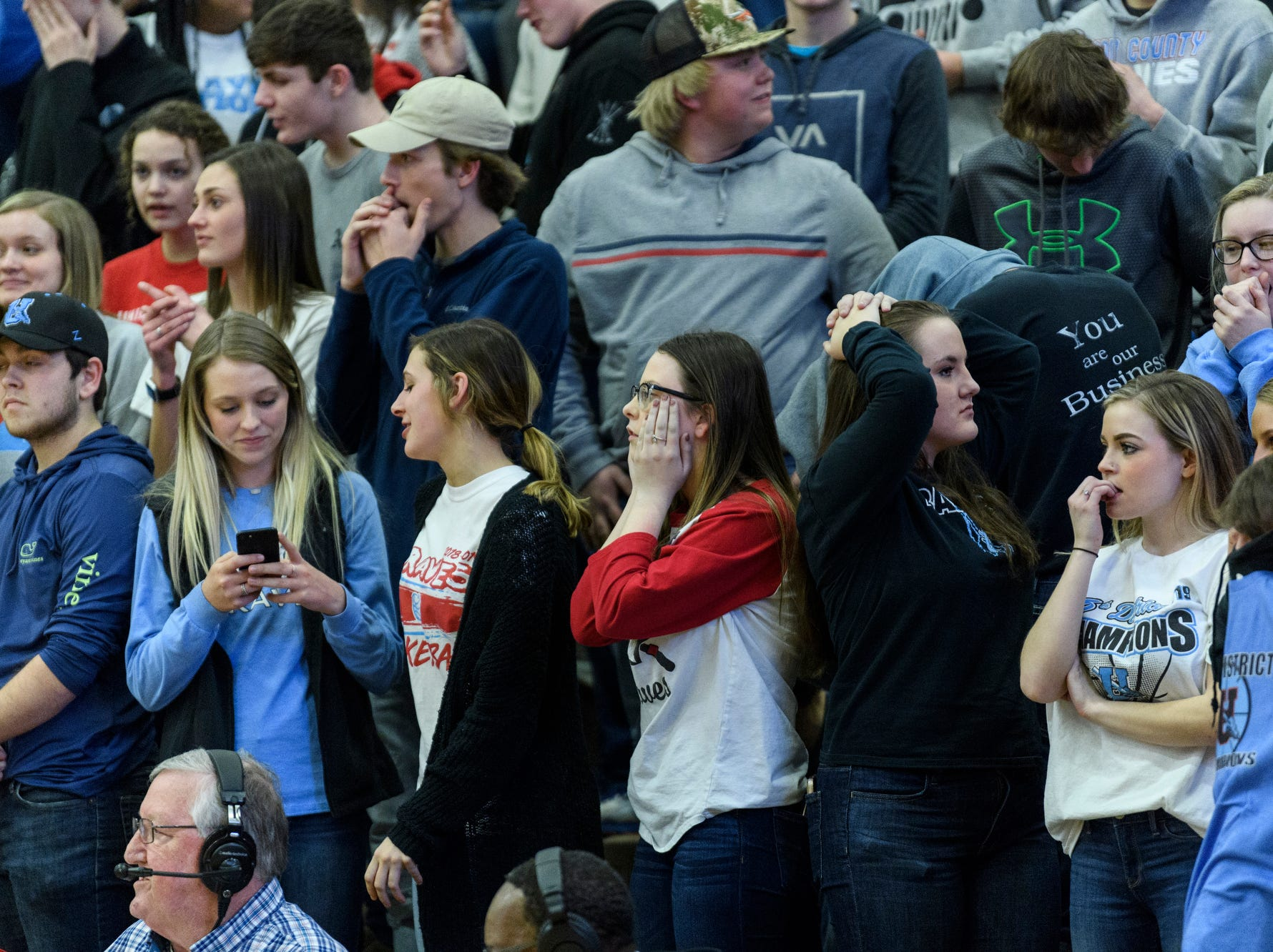 Union County Braves fans react to a close game with against the Caldwell County Tigers during the Boys Second Region tournament at Madisonville-North Hopkins High School in Madisonville, Ky., Monday, Feb. 25, 2019. The Tigers defeated the Braves 67-64 to advance to Friday's second region semifinal against University Heights Academy.