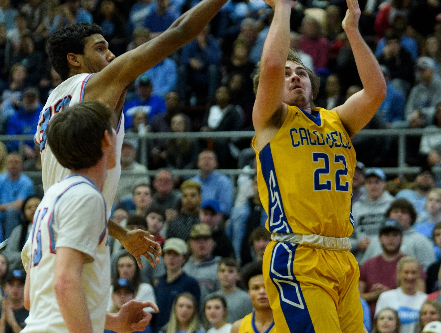 Caldwell County's Cayden Fraliex (22) goes for the net during the Boys Second Region tournament against the Union County Braves at Madisonville-North Hopkins High School in Madisonville, Ky., Monday, Feb. 25, 2019. The Tigers defeated the Braves 67-64 to advance to Friday's second region semifinal against University Heights Academy.