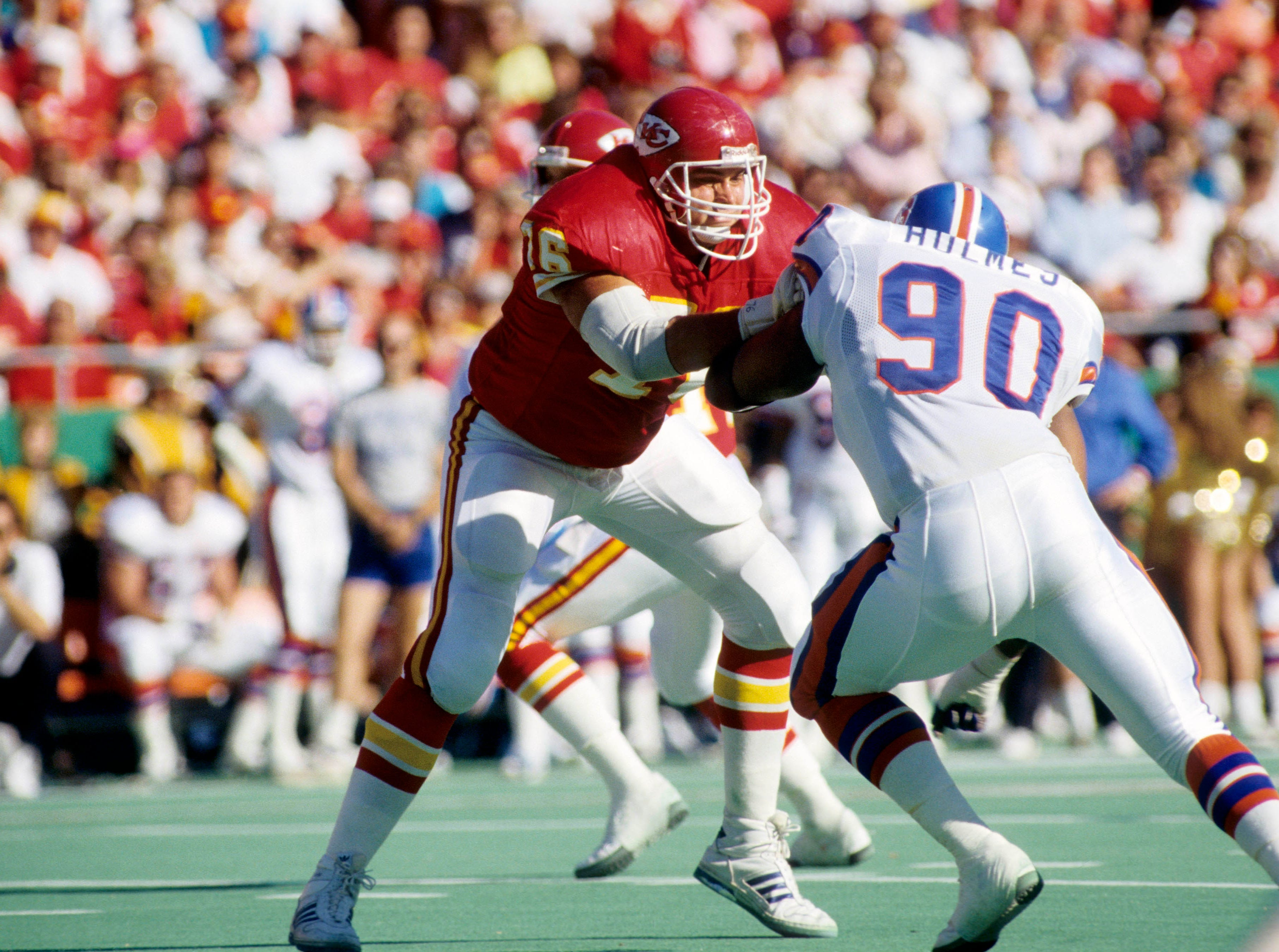 Kansas City Chiefs tackle John Alt (76) blocks Denver Broncos defensive end Ron Holmes (90) at Arrowhead Stadium in 1989. Alt, a former Iowa Hawkeye, was taken with the 21st pick of the first round in the 1984 NFL Draft.