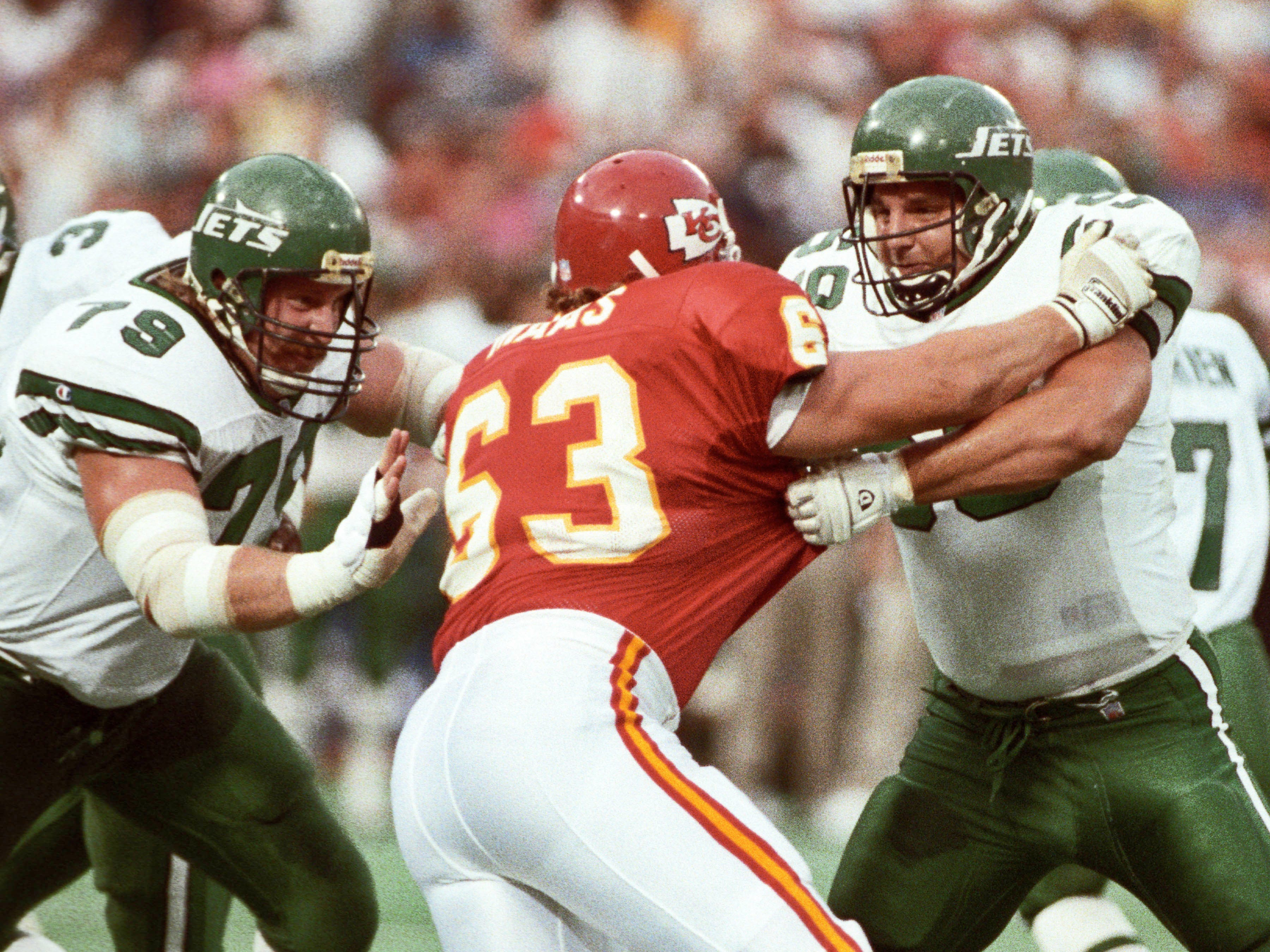 New York Jets offensive linemen Mike Haight, left, and Jeff Criswell in action against Kanas City Chiefs defensive end Bill Maas (63) at Busch Stadium during the 1991 preseason. Haight, a former Hawkeye, was selected with the 22nd pick in the 1986 NFL Draft by the Jets.