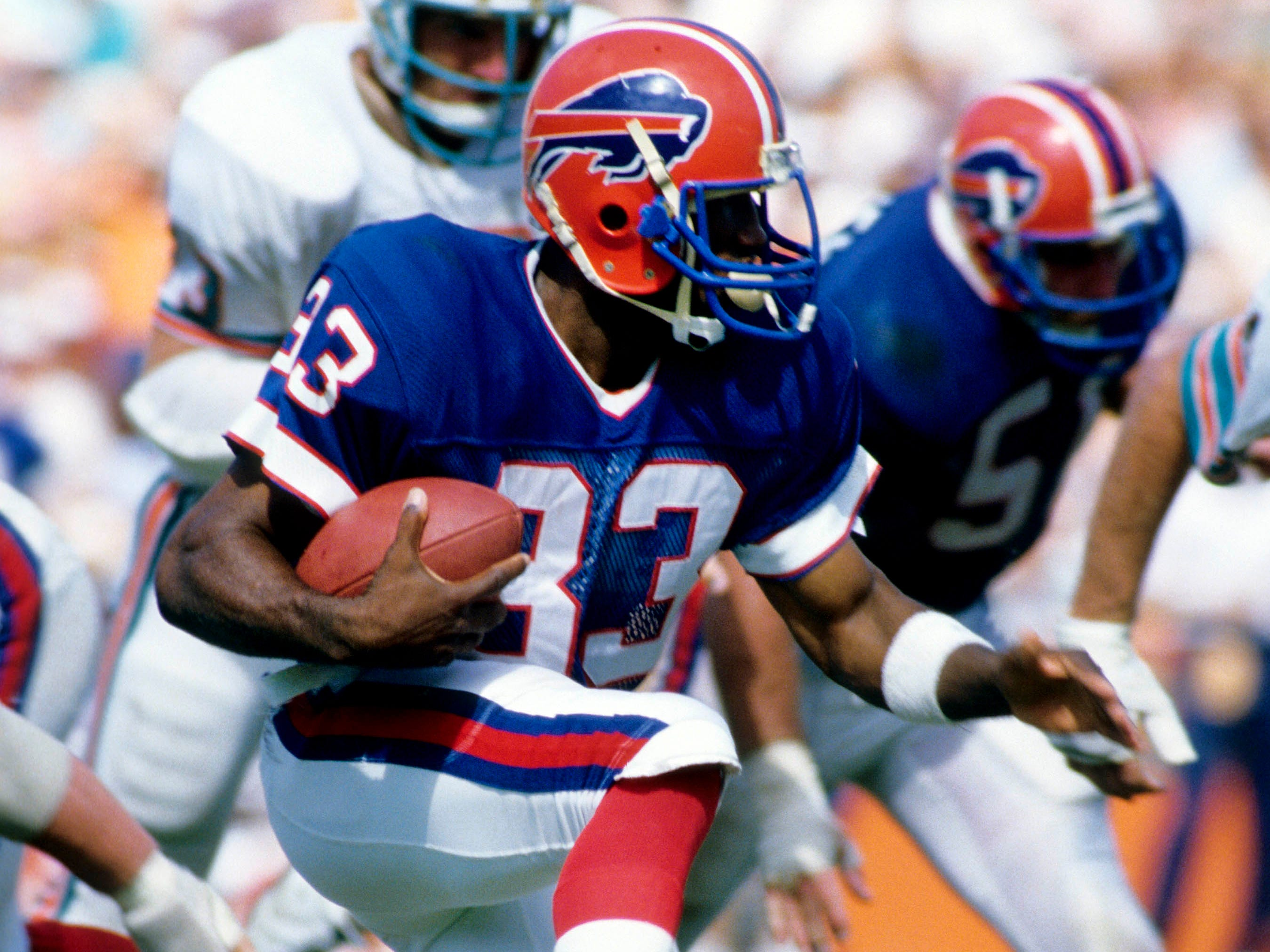 Buffalo Bills rookie running back Ronnie Harmon (33) against the Miami Dolphins in 1986. Harmon, a former Iowa Hawkeye, was the 16th overall pick by the Bills in the 1986 NFL Draft.