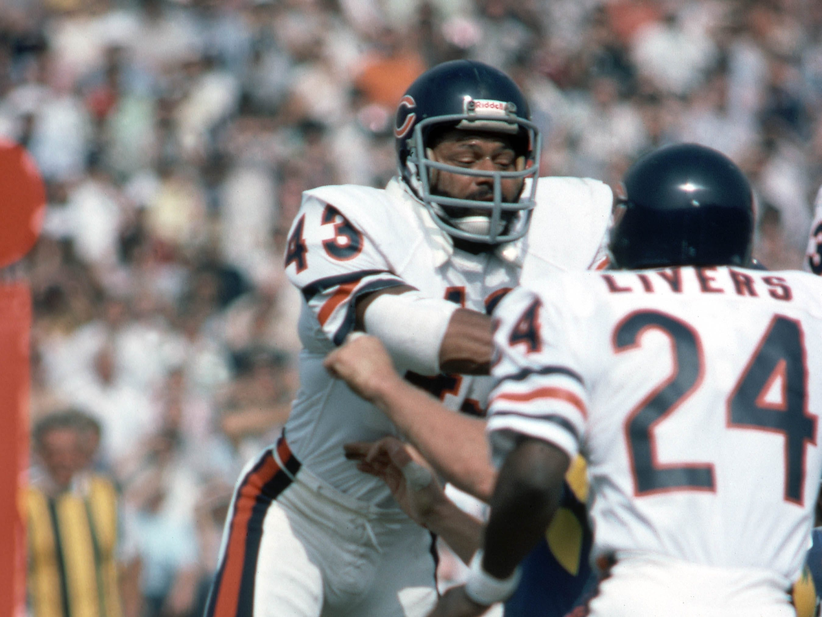 Chicago Bears defensive players Craig Clemons (43) and Virgil Livers (24) in action against the Los Angeles Rams at Los Angeles Memorial Coliseum in 1976.  Clemons, a former Iowa Hawkeye, was the 12th pick of the first round of the 1972 NFL Draft by the Chicago Bears.