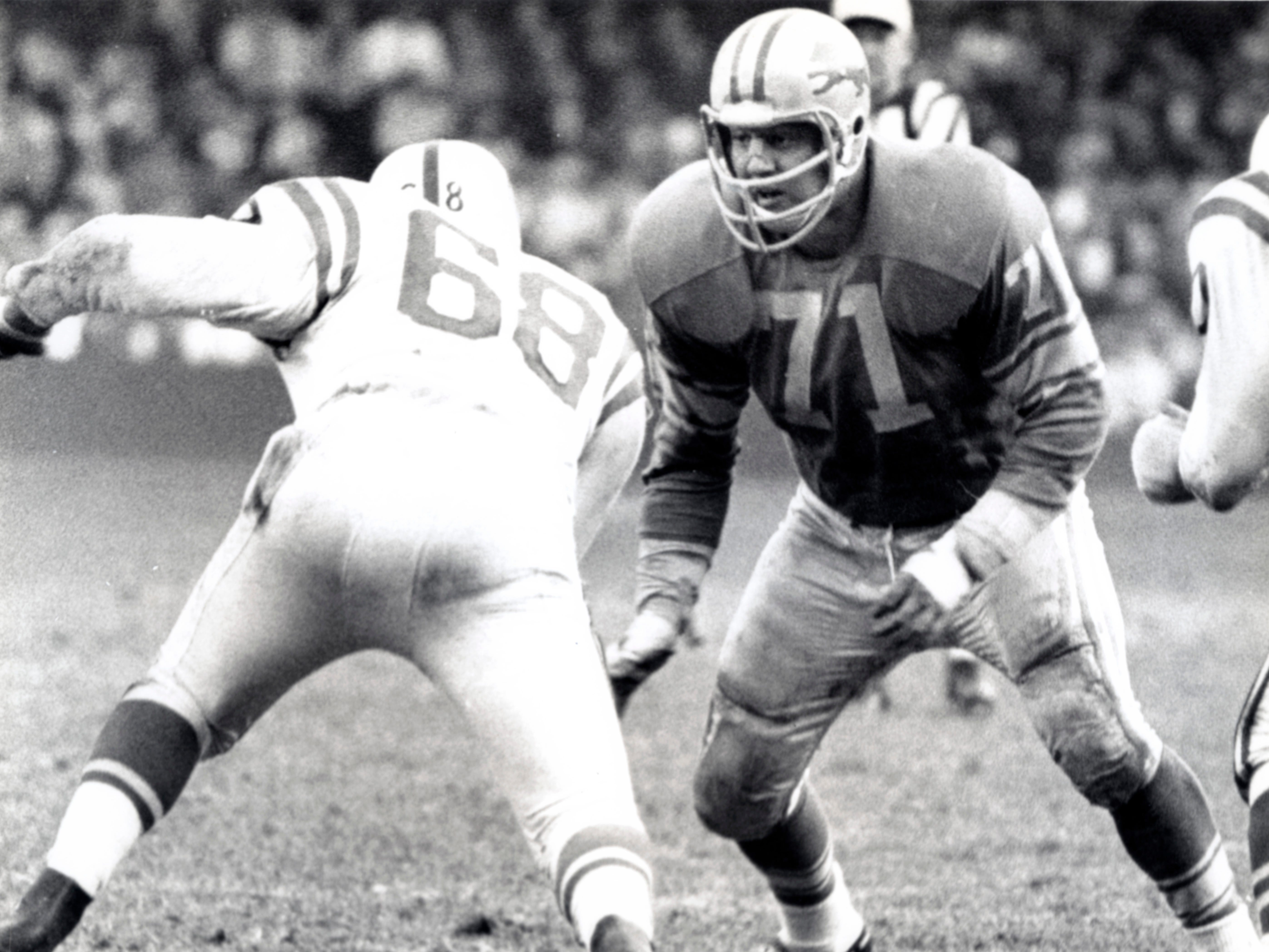Detroit Lions defensive tackle Alex Karras (71) in action against the Baltimore Colts at Tigers Stadium in 1964. Karras, a former Iowa Hawkeye, was taken 10th overall by the Detroit Lions in the 1958 NFL Draft.