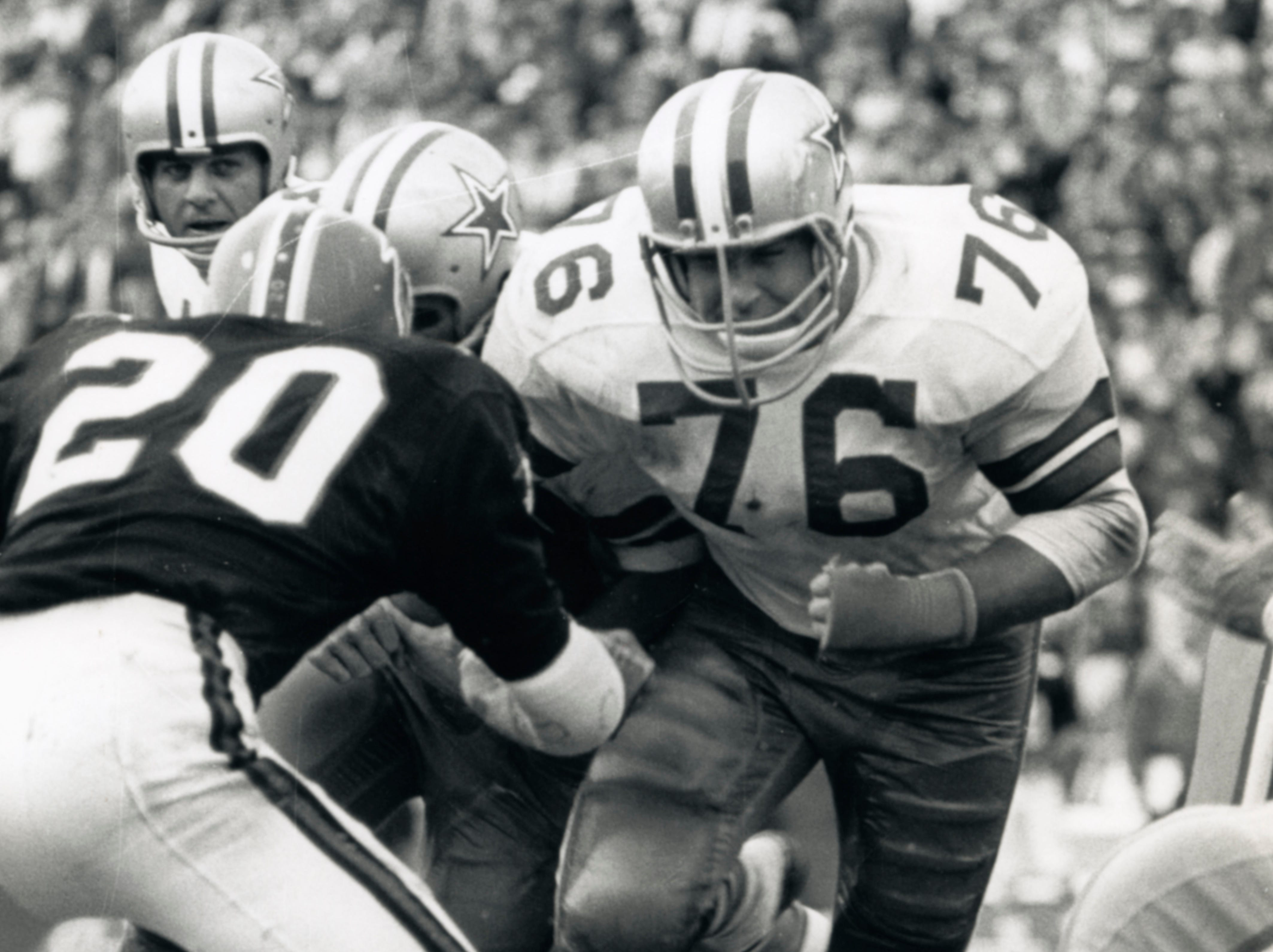 Dallas Cowboys guard John Niland (76) in action during a 1967 game against the Atlanta Falcons. Niland, a former Iowa Hawkeye, was taken fifth overall by the Cowboys in the 1966 NFL Draft.