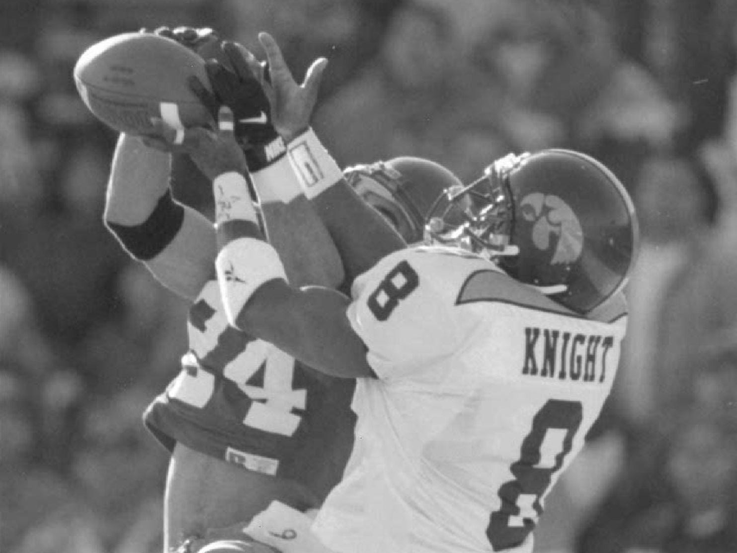 Iowa defensive back Tom Knight defends a pass to  Washinton's Jerome Pathon in the 1995 Sun Bowl. Knight was the ninth overall pick by the Arizona Cardinals in the 1997 NFL Draft.