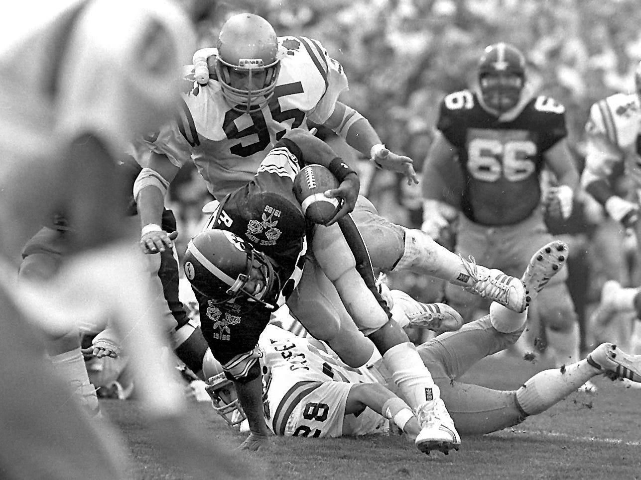 Iowa's Ronnie Harmon shown in the 1986 Rose Bowl against Washington.