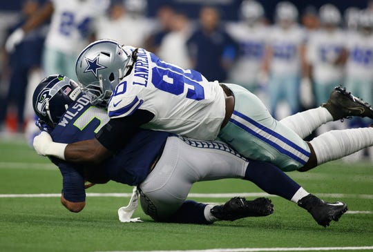 Jan 5, 2019; Arlington, TX, USA; Dallas Cowboys defensive end Demarcus Lawrence (90) sacks Seattle Seahawks quarterback Russell Wilson (3) in the first quarter in a NFC Wild Card playoff football game at AT&T Stadium.