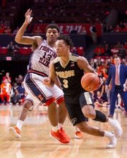 Boilermakers guard Carsen Edwards (3) drives to the basket defended by Illinois Fighting Illini guard Mark Smith last season in Champaign.