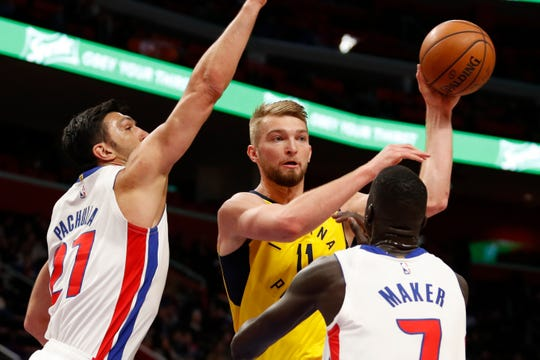 Feb 25, 2019; Detroit, MI, USA; Indiana Pacers forward Domantas Sabonis (11) passes the ball against Detroit Pistons center Zaza Pachulia (27) and forward Thon Maker (7) during the second quarter at Little Caesars Arena.