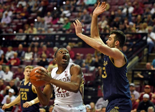 Feb 25, 2019; Tallahassee, FL, USA; Florida State Seminoles forward Mfiondu Kabengele (25) works the ball past Notre Dame Fighting Irish forward John Mooney (33) during the first half at Donald L. Tucker Center.