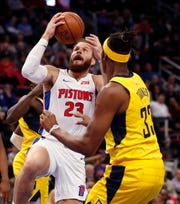 Detroit Pistons forward Blake Griffin (23) makes a layup as Indiana Pacers center Myles Turner (33) defends during the first half of an NBA basketball game, Monday, Feb. 25, 2019, in Detroit.