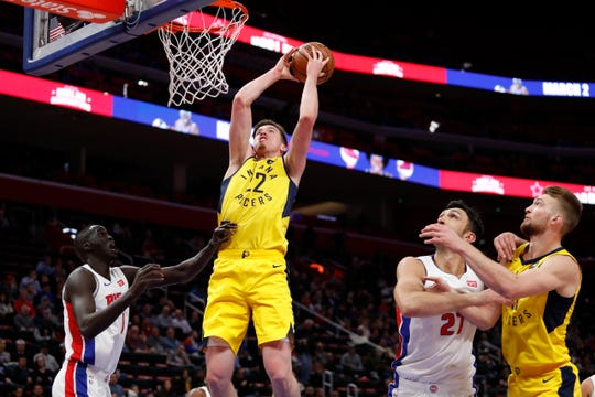 Pacers forward T.J. Leaf (22) takes a shot against Detroit Pistons forward Thon Maker (7) during the second quarter at Little Caesars Arena.