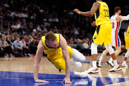 Pacers forward Domantas Sabonis (11) falls on the court after being injured during the fourth quarter against the Detroit Pistons at Little Caesars Arena.