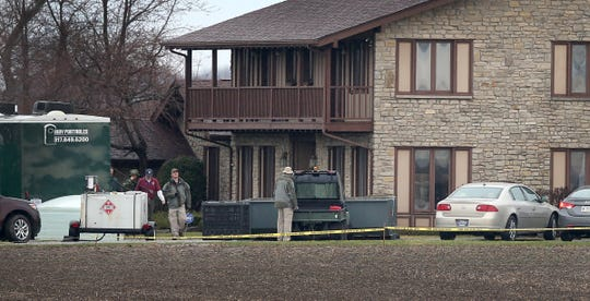 Local FBI, State Police and Rush County Sheriff deputies  on the scene at the home of Don Miller's home in 2014.