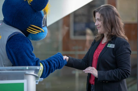 Roberta Jaggers, President of The Indianapolis Public Library Foundation, greets mascot Boomer during an announcement for an initiative called 'Next 50' which will seek to raise $150,000 in public donations to the Indianapolis Public Library, Tuesday, Feb. 26, 2019. Children's reading and learning initiatives are the beneficiaries of the program that is being aided by mascots from the Indians, Colts, and Pacers.