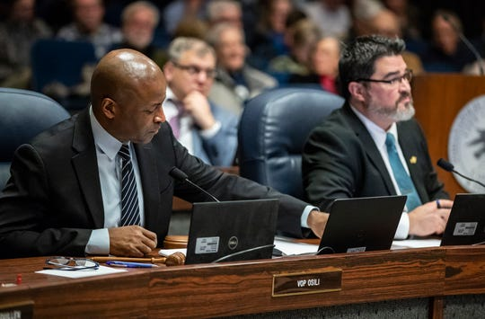 From left, Council President Vop Osili and Vice President Zach Adamson lead a full council meeting at the City-County Building in Indianapolis on Monday, Feb. 25, 2019.