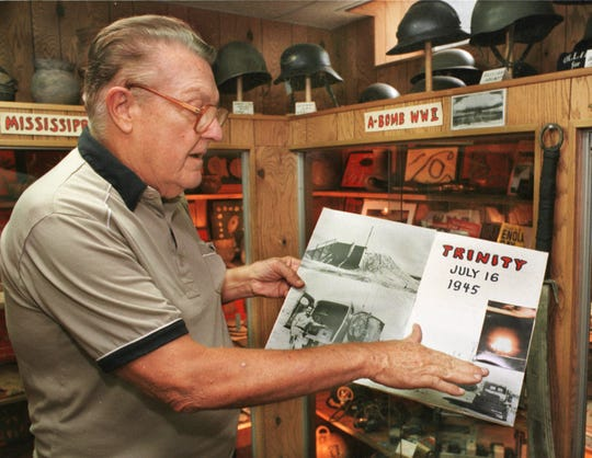 8-11-98 Don Miller, rural Waldron, points to a picture of an atomic bomb test blast where he gave the signal to begin the countdown in 1945. The blast on a the Bikini atoll left Miller with hearing damage even though he was six miles from the explosion.