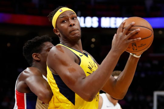 Feb 25, 2019; Detroit, MI, USA; Indiana Pacers center Myles Turner (33) gets defended by Detroit Pistons guard Langston Galloway (9) during the second quarter at Little Caesars Arena.