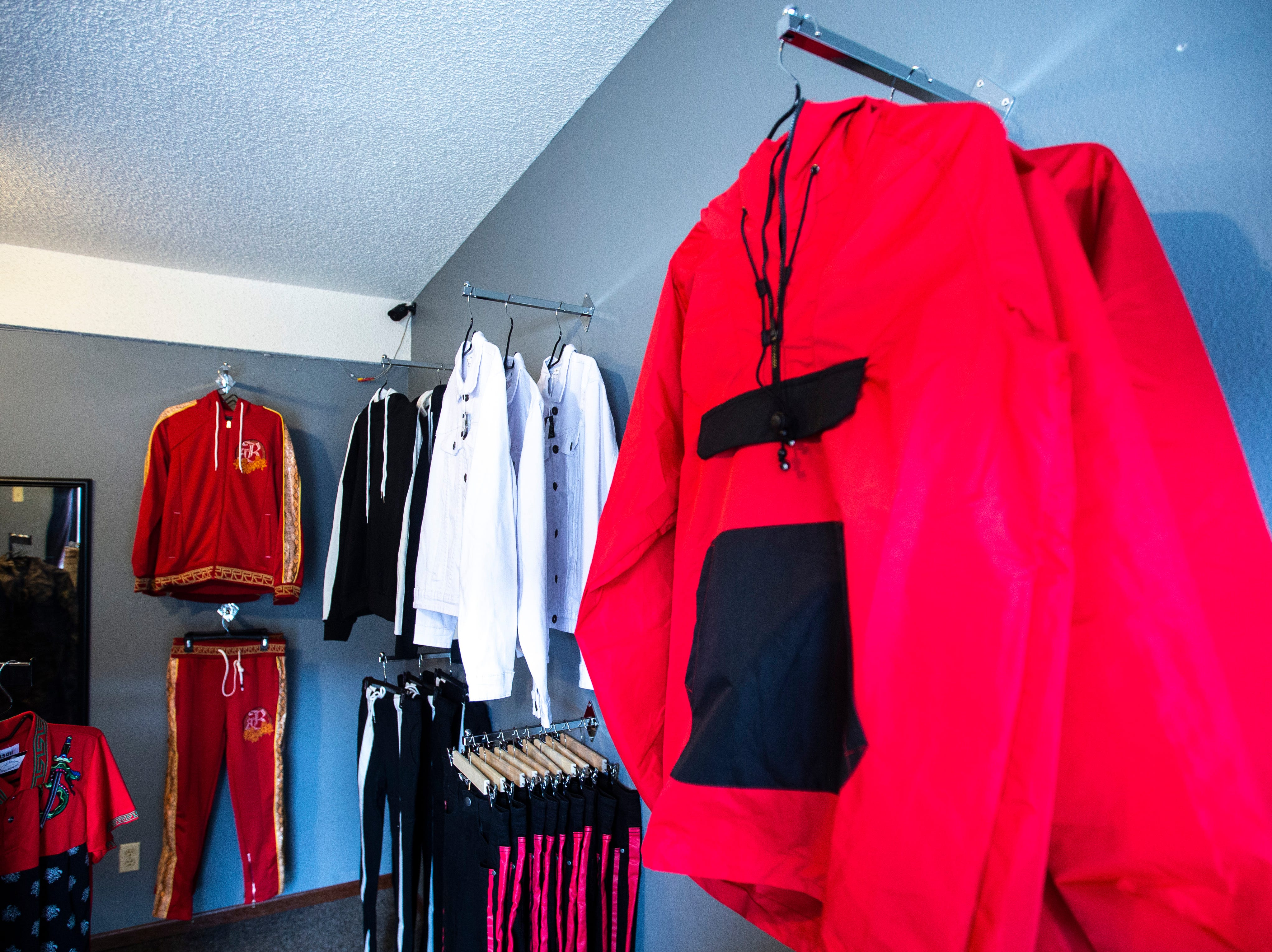 Jackets and jumpsuits hang on racks on Tuesday, Feb. 26, 2019, inside Finer Streetwear Co. at 441 Highway 1 West in Iowa City, Iowa.