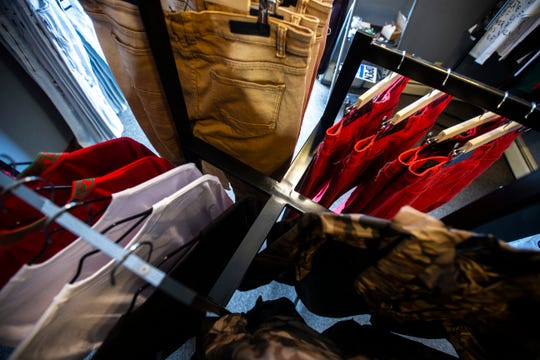 Jackets and pants hang on racks on Tuesday, Feb. 26, 2019, inside Finer Streetwear Co. at 441 Highway 1 West in Iowa City, Iowa.