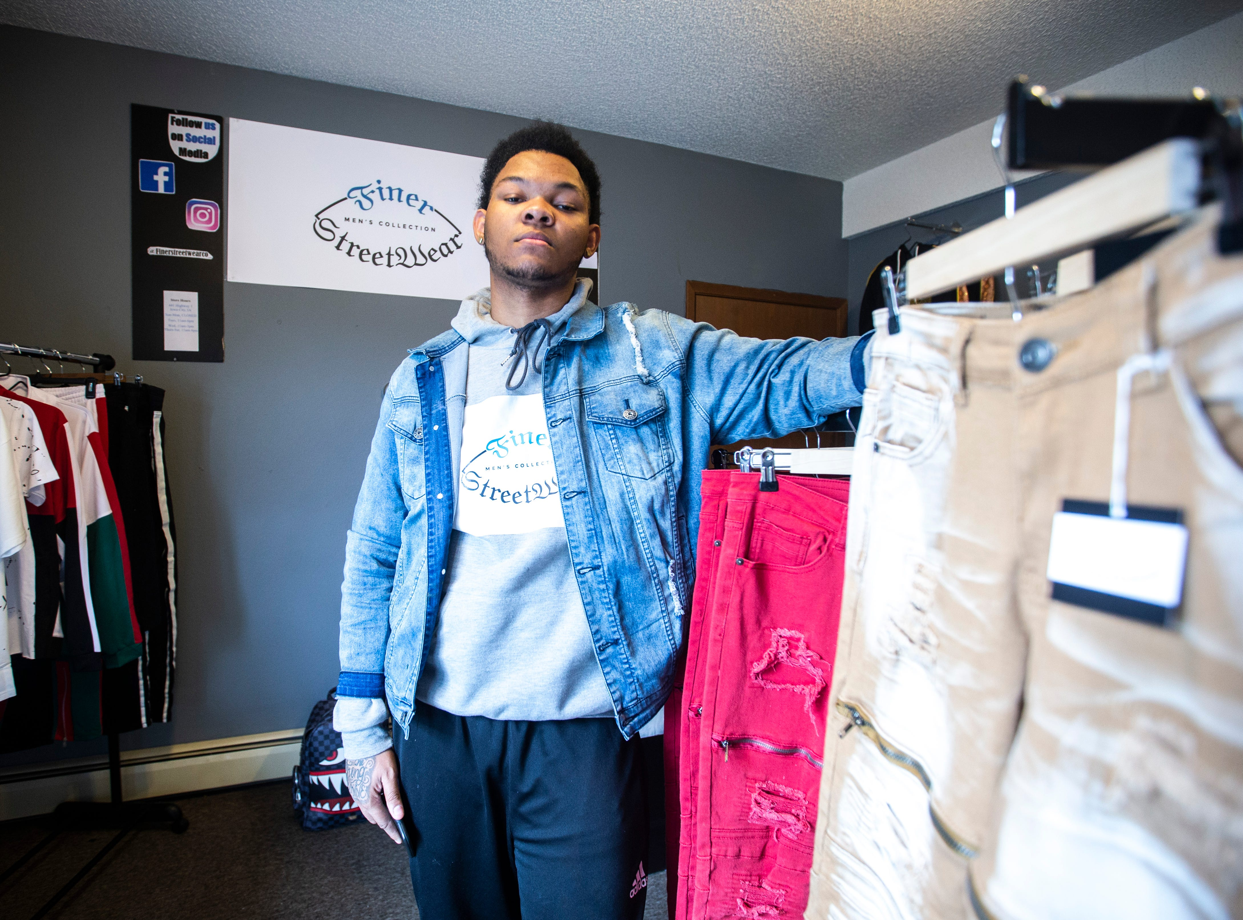 Markeece Johnson poses for a portrait on Tuesday, Feb. 26, 2019, inside Finer Streetwear Co. at 441 Highway 1 West in Iowa City, Iowa. Johnson opened the store in November of 2018.