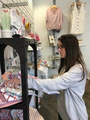 Anna Bagley of Madison shops for Copper Pearl bandana-style bibs at Highland Park by Material Girls in Ridgeland.