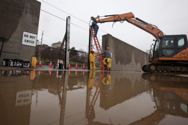 Workers with the City of Vicksburg start construction on one of the three flood wall gates on Levee Street in Vicksburg Miss., on Thursday Feb. 21, 2019.