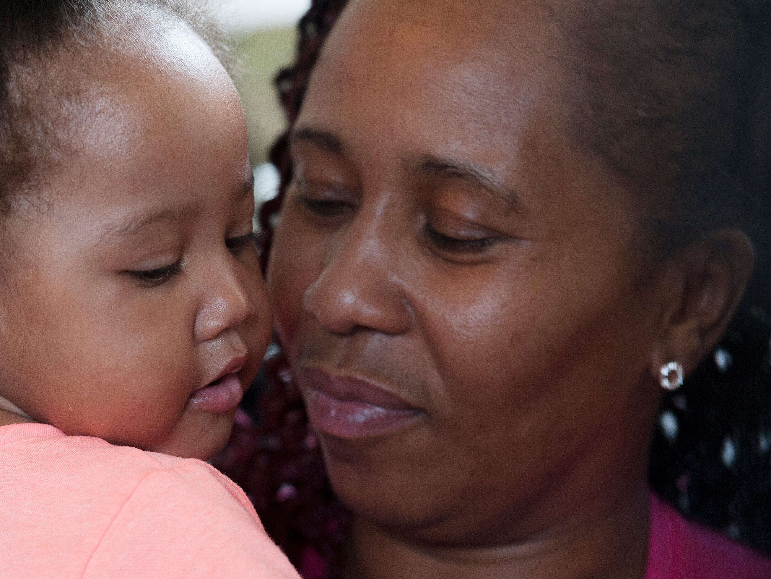 """Makeska Shoemaker holds her granddaughter, A'Dore, 1, in their Aberdeen home Monday, Feb. 25, 2019. In the early hours of Sunday, Jan. 27, 2019, A'Dore's mother, Shyteria Shardae """"Shy"""" Shoemaker, died after family members rushed to get her medical care in a county where there is no emergency room. Makeska Shoemaker wonders how long it will be before the toddler understands her mother isn't coming home."""